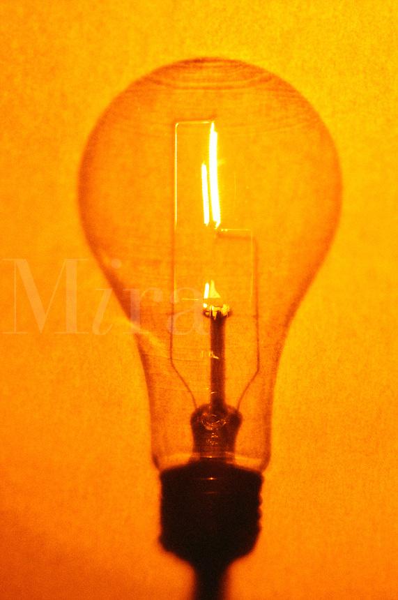 Illuminated lightbulb with grainy warm tones