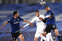 16th March 2021; Madrid, Spain; during the Champions League match, round of 16, between Real Madrid and Atalanta;  Federico Valverde, Cristian Romero and Berat Djimsiti