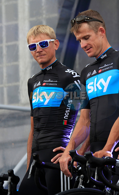 Sky Procycling team riders Kanstantsin Siutsou (BLR) and Michael Rogers (AUS) on stage at the Team Presentation Ceremony before the 2012 Tour de France in front of The Palais Provincial, Place Saint-Lambert, Liege, Belgium. 28th June 2012.<br /> (Photo by Eoin Clarke/NEWSFILE)