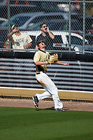 UCF Knights center fielder Luke Hamblin (12) attempts to make a play on a home run hit by Joe Drpich (not shown) during a game against the Siena Saints on February 21, 2016 at Jay Bergman Field in Orlando, Florida.  UCF defeated Siena 11-2.  (Mike Janes/Four Seam Images)