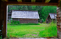 View of Kestner Homestead Outbuildings framed in Barn passageway. Olympic National Park, Quinault, Washington State.