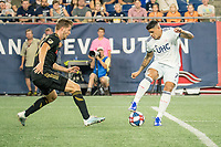 FOXBOROUGH, MA - AUGUST 4: Gustavo Bao #7 of New England Revolution near the Los Angeles goal with Walker Zimmerman #25 of Los Angeles FC defending during a game between Los Angeles FC and New England Revolution at Gillette Stadium on August 3, 2019 in Foxborough, Massachusetts.