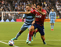 KANSAS CITY, KS - JULY 31: Johnny Russell #7 of Sporting Kansas City tries to get past Ryan Hollingshead #12 of FC Dallas during a game between FC Dallas and Sporting Kansas City at Children's Mercy Park on July 31, 2021 in Kansas City, Kansas.