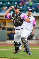 Winston-Salem Dash catcher Kevan Smith (24) makes a throw to first base against the Wilmington Blue Rocks at BB&T Ballpark on April 20, 2013 in Winston-Salem, North Carolina.  The Dash defeated the Blue Rocks 4-2 in game one of a double-header.  (Brian Westerholt/Four Seam Images)