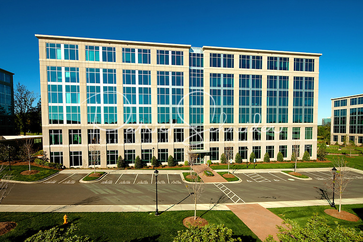 """Photography of Charlotte NC's Ballantyne Corporate Park, a 535-acre master-planned office and business community located south of Charlotte in Ballantyne, NC. Image is of the Hayes Building, one of Charlotte's first """"green"""" speculative building, according to the Ballantyne Corporate Park. Photo was taken on a weekend in order to show the building without vehicles in the parking lot. The Hayes building is home to Mitsubishi Nuclear Energy Systems."""