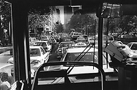 Australia. New South Wales. Sydney. Downtown. City Center. Traffic jam. Congested traffic. Public bus. Cars, taxis and buses queue on line. 11.3.99  © 1999 Didier Ruef