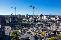 "High-rise construction cranes along interstate 35 (IH-35) fill the downtown Austin Skyline. Downtown Austin's Construction Boom is the fastest growing in the country. Dozens of downtown Austin hotel, office, retail and residential projects are underway or about to begin, spurred by an ""influx of young and highly educated workers"" and the arrival of tech companies including Apple, Microsoft, Facebook, Google, Twitter, Instagram, Oracle and Cirrus Logic."