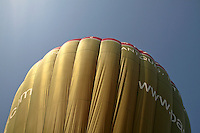 The ballons' nylon envelopes are fully inflated with hot air from the propane burners, British School of ballooning, Ebernoe, West Sussex.