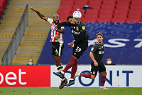 Nigel Atangana of Exeter City and Vadaine Oliver of Northampton Town in an aerial battle during the Sky Bet League 2 PLAY-OFF Final match between Exeter City and Northampton Town at Wembley Stadium, London, England on 29 June 2020. Photo by Andy Rowland.