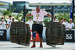 HAINAN ISLAND, CHINA - AUGUST 23:  Terry Hollands of United Kingdom competes at the Super Yoke event during the World's Strongest Man competition at Serenity Marina on August 23, 2013 in Hainan Island, China.  Photo by Victor Fraile