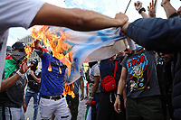 Pictured: Anti-Israel protesters burn an Israel flag in Athens, Greece. Saturday 15 May 2021<br /> Re: Palestinian people living in Greece, joined by local supporters protesting against Israel, have clashed with police in central Athens, Greece.