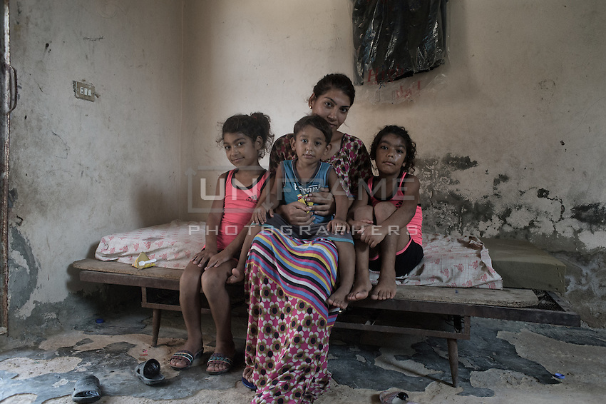 Palestinian family posing inside their home. the father didnt want to be in the picture. Shatila, Beirut, Lebanon. August 2015