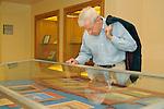Joe Kellor studying historic documents at Bucknell University Library archives.