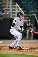 Jackson Generals designated hitter Rudy Flores (11) follows through on a swing during a game against the Chattanooga Lookouts on April 27, 2017 at The Ballpark at Jackson in Jackson, Tennessee.  Chattanooga defeated Jackson 5-4.  (Mike Janes/Four Seam Images)