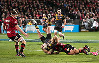 Codie Taylor takes out Damien McKenzie in midair during the 2021 Super Rugby Aotearoa final between the Crusaders and Chiefs at Orangetheory Stadium in Christchurch, New Zealand on Saturday, 8 May 2021. Photo: Joe Johnson / lintottphoto.co.nz