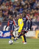 New England Revolution midfielder Shalrie Joseph (21) passes the ball. The Columbus Crew defeated the New England Revolution, 1-0, at Gillette Stadium on October 10, 2009.