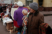 """Moscow, Russia<br /> October 1992<br /> <br /> An elderly woman sells various items along a street side in central Moscow. This was a very common scene in Moscow just after the collapse of the Soviet Union was disbanded. <br /> <br /> In December 1991, food shortages in central Russia had prompted food rationing in the Moscow area for the first time since World War II. Amid steady collapse, Soviet President Gorbachev and his government continued to oppose rapid market reforms like Yavlinsky's """"500 Days"""" program. To break Gorbachev's opposition, Yeltsin decided to disband the USSR in accordance with the Treaty of the Union of 1922 and thereby remove Gorbachev and the Soviet government from power. The step was also enthusiastically supported by the governments of Ukraine and Belarus, which were parties of the Treaty of 1922 along with Russia.<br /> <br /> On December 21, 1991, representatives of all member republics except Georgia signed the Alma-Ata Protocol, in which they confirmed the dissolution of the Union. That same day, all former-Soviet republics agreed to join the CIS, with the exception of the three Baltic States."""