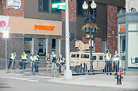 Massachusetts National Guard Military Police stand with a Humvee outside a Dunkin' Donuts store on Tremont Street in Boston, Massachusetts, on Sun., June 7, 2020. After isolated attacks on businesses earlier in the week and small clashes with police, Massachusetts and other states activated National Guard units to provide security as nationwide demonstrations against police brutality continue in the weeks after George Floyd was killed by police in Minneapolis on May 25, 2020.