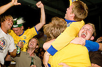 Sweden fans watch their team's World Cup match against Paraguay on June 15, 2006 at Slate, a New York City nightclub.<br /> <br /> The World Cup, held every four years in different locales, is the world's pre-eminent sports tournament in the world's most popular sport, soccer (or football, as most of the world calls it).  Qualification for the World Cup is open to any country with a national team accredited by FIFA, world soccer's governing body. The first World Cup, organized by FIFA in response to the popularity of the first Olympic Games' soccer tournaments, was held in 1930 in Uruguay and was participated in by 13 nations.    <br /> <br /> As of 2010 there are 208 such teams.  The final field of the World Cup is narrowed down to 32 national teams in the three years preceding the tournament, with each region of the world allotted a specific number of spots.  <br /> <br /> The World Cup is the most widely regularly watched event in the world, with soccer teams being a source of national pride.  In most nations, the whole country is at a standstill when their team is playing in the tournament, everyone's eyes glued to their televisions or their ears to the radio, to see if their team will prevail.  While the United States in general is a conspicuous exception to the grip of World Cup fever there is one city that is a rather large exception to that rule.  In New York City, the most diverse city in a nation of immigrants, the melting pot that is America is on full display as fans of all nations gather in all possible venues to watch their teams and celebrate where they have come from.