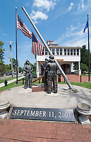 Brockport New York NY small town with  Ground Zero Statue for 9/11 fire fighters hero memorial with USA flag at the Fire Museum in Brockport