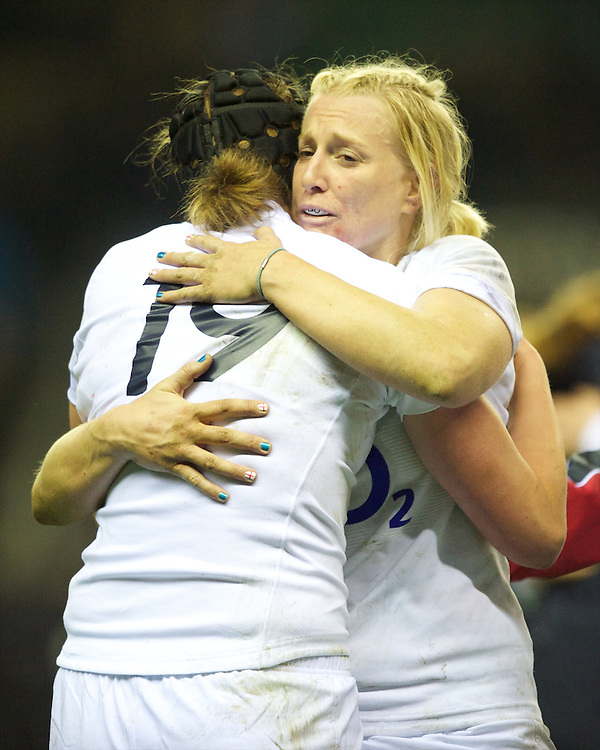 Tamara Taylor of England Women (right) hugs Emily Braund of England Women as they celebrate winning the test match between England Women and the Black Ferns at Twickenham on Saturday 01 December 2012 (Photo by Rob Munro)