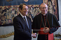 Cardinal Pietro Parolin, Cyprus' President Nicos Anastasiades upon his arrival for a private audience at the Vatican on November 18, 2019.