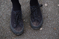 "COPY BY TOM BEDFORD<br /> Pictured: Shoes worn by a pupil at Ysgol Penglais School in Aberystwyth, Wales, UK<br /> Re: More than 400 pupils at a comprehensive school in Aberystwyth were given detention on their first day back for breaking school uniform rules.<br /> The uniform was changed at Ysgol Penglais over the summer, following a consultation.<br /> But a number of parents have complained to the school and some 250 have signed a petition saying the punished pupils were ""treated unfairly"".<br /> Ceredigion council said a large number of pupils were kept in at break times.<br /> The new uniform was brought in for the start of the new academic year, with the old navy blue pullover and white polo shirt replaced by a grey v-neck jumper, white shirt and a tie. Sixth formers have a similar outfit.<br /> It is compulsory for all pupils in years 7 and 12 to wear the new uniform, with other students being given the rest of the year to buy it.<br /> This was outlined in correspondence sent to all parents over the summer months, which also stipulated what trousers, skirts and shoes would be deemed acceptable.<br /> But the petition said the new rules were not clear enough and that the pupils should not have been punished for their parents' mistakes.<br /> It also said a warning should have been given before the detention."