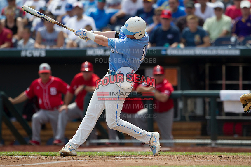 North Carolina third baseman Colin Moran (18) swings the bat during Game 3 of the 2013 Men's College World Series against the North Carolina State Wolfpack at TD Ameritrade Park on June 16, 2013 in Omaha, Nebraska. The Wolfpack defeated the Tar Heels 8-1. (Andrew Woolley/Four Seam Images)