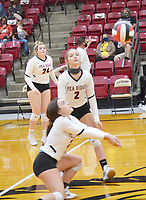 Junior varsity Lady Blackhawks McKyah Lipscomb and Demi Rosser keep their eyes on the volleyball during the game Thursday, Oct. 8, against the junior varsity Lady Cardinals from Farmington.