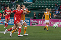 Brittany Bock (21) of the Western New York Flash, left and Keeley Dowling of the Atlanta Beat battle for the ball during the first half of their WPS match at Sahlen's Stadium in Rochester, NY May 01, 2011. New York 3, Atlanta 0.