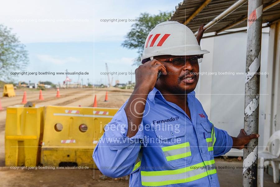 MOZAMBIQUE, Moatize, opencast Benga coal mine of Rio Tinto, coal is transported by railway to port Beira for export, Rio Tinto has sold the mine 2014 to indian consortium International Coal Ventures Private Limited ICVL  / MOSAMBIK, Moatize, Benga Kohlmine, offener Kohle Tagebau von Rio Tinto, die Kohle wird von hier per Bahn fuer den Export zum Hafen Beira transportiert, Rio Tinto hat den Kohletagebau 2014 an das indische Konsortium International Coal Ventures Private Limited (ICVL) verkauft, Lokfuehrer FERNANDO P., war bis 1989 in der DDR zur Ausbildung in einem Getraenkekombinat in Leipzig