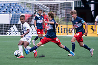 FOXBOROUGH, MA - JULY 4: Noel Buck #61 of the New England Revolution II tries to intercept a pass from Andrew Booth #19 of Greenville Triumph SC during a game between Greenville Triumph SC and New England Revolution II at Gillette Stadium on July 4, 2021 in Foxborough, Massachusetts.