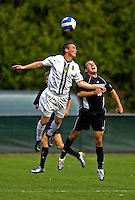 31 October 2007: The University of Vermont Catamounts' Jordan Crasilneck, a Junior from Eugene, OR, jumps high for a header during a game against the University of Binghamton Bearcats at Historic Centennial Field in Burlington, Vermont. The Catamounts shut out the visiting Bearcats 2-0...Mandatory Photo Credit: Ed Wolfstein Photo