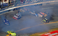 Feb 7, 2009; Daytona Beach, FL, USA; ARCA RE/MAX Series drivers Frank Kimmel (44) John Ferrier (99) Peyton Sellers (47) Chase Mattioli (94) Ken Weaver (4) and Alli Owens (19) crash during the Lucas Oil Slick Mist 200 at Daytona International Speedway. Mandatory Credit: Mark J. Rebilas-