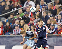 Sporting Kansas City forward Jacob Peterson (37) and New England Revolution midfielder Diego Fagundez (14) battle for head ball. In the first game of two-game aggregate total goals Major League Soccer (MLS) Eastern Conference Semifinal series, New England Revolution (dark blue) vs Sporting Kansas City (light blue), 2-1, at Gillette Stadium on November 2, 2013.
