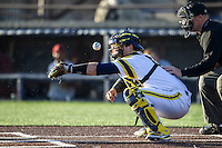Michigan Wolverines catcher Harrison Wenson (7) takes one off the mask against the Central Michigan Chippewas on March 29, 2016 at Ray Fisher Stadium in Ann Arbor, Michigan. Michigan defeated Central Michigan 9-7. (Andrew Woolley/Four Seam Images)