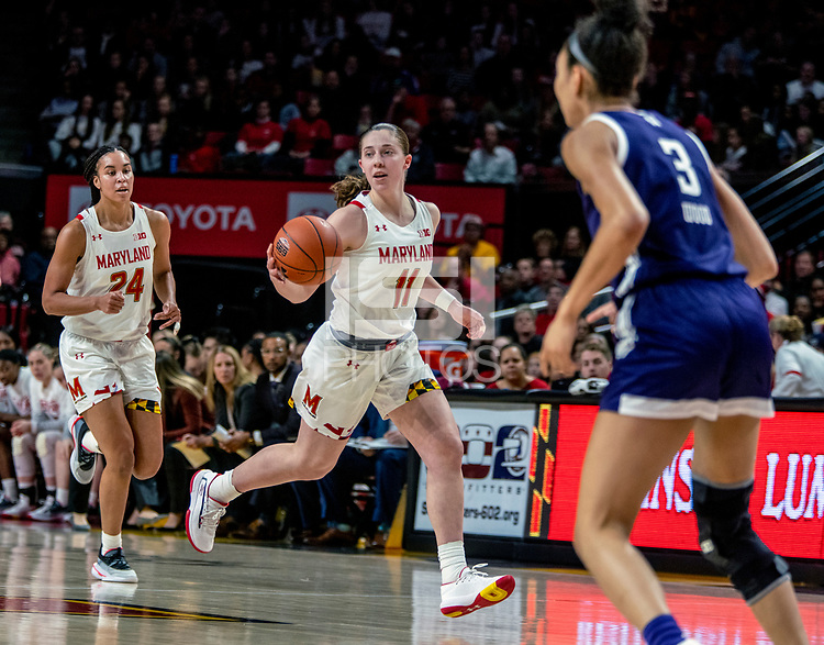COLLEGE PARK, MD - JANUARY 26: Taylor Mikesell #11 of Maryland moves up court during a game between Northwestern and Maryland at Xfinity Center on January 26, 2020 in College Park, Maryland.