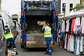 Dustmen employed by contractor SITA clear market refuse in Portobello Road, Kensington & Chelsea, London.