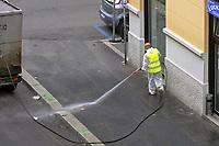 - Epidemia di virus Covid-19, sanificazione della strada con liquido disinfettante dopo la giornata di mercato<br /> <br /> - Covid-19 virus epidemic, sanitization of the street with disinfectant liquid after a market day