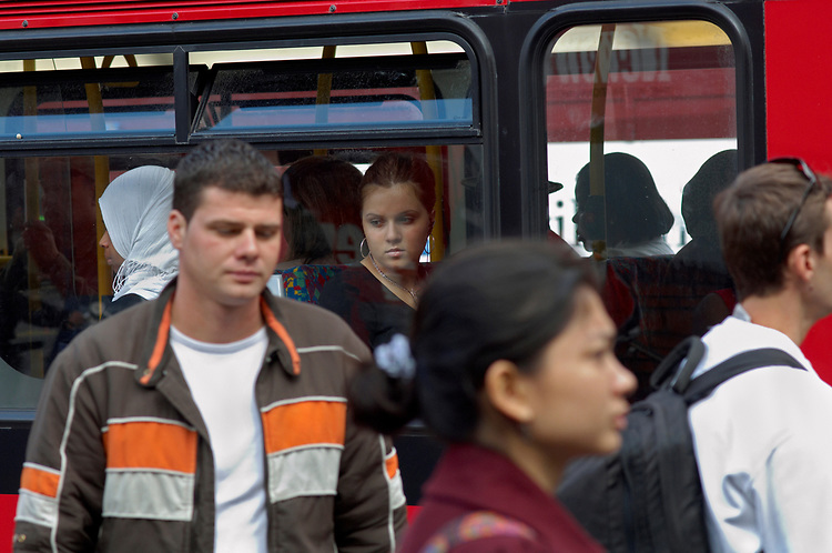 © John Angerson <br /> Passengers and staff at the Victoria Bus station, London<br /> <br /> +44 (0) 7767 822828