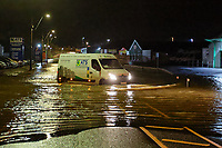 Pictured: A van travels though flooded Pensarn Road in Carmarthen, Wales, UK. Saturday 13 October 2018<br /> Re: River Towy has burst its banks and adjacent properties have flooded, caused by storm Callum, in Carmarthen, west Wales, UK.