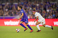 Orlando, FL - Saturday March 24, 2018: Orlando Pride forward Marta Vieira da Silva (10) dribbles away from Utah Royals midfielder Desiree Scott (11) during a regular season National Women's Soccer League (NWSL) match between the Orlando Pride and the Utah Royals FC at Orlando City Stadium. The game ended in a 1-1 draw.