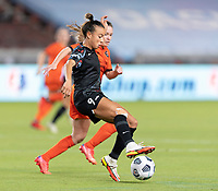 HOUSTON, TX - SEPTEMBER 10: Mallory Pugh #9 of the Chicago Red Stars gains control of a loose ball during a game between Chicago Red Stars and Houston Dash at BBVA Stadium on September 10, 2021 in Houston, Texas.