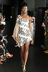 Porsche walks runway in an asymmetrical cold shoulder sequin dress from the Carlton Jones Resort 2017 collection fashion show at Le Bain in The Standard Hotel in New York City, on June 8, 2017.