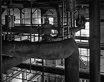 A network of hot and cold water and steam pipes at a power plant
