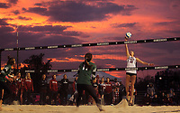 The sun sets behind South Carolina beach volleyball in Columbia. (Travis Bell/SIDELINE CAROLINA)