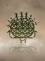"Bronze Age Hattian ceremonial standard known as ""Sun Disks"" from Bronze Age grave BM (2500 BC to 2250 BC), possibly a Royal grave - Alacahoyuk - Museum of Anatolian Civilisations, Ankara, Turkey. Against a warm art background"