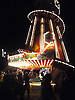 An illuminated Helter Skelter at The Rolling Stones Gig in Hyde Park the summer of 2013.<br /> <br /> A spiral slide around a tower at an amusement park. Helter Skelter or Helter-skelter, originally meaning confused or disorderly haste.