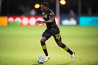 LAKE BUENA VISTA, FL - JULY 16: Derrick Etienne #22 of the Columbus Crew SC dribbles the ball during a game between New York Red Bulls and Columbus Crew at Wide World of Sports on July 16, 2020 in Lake Buena Vista, Florida.