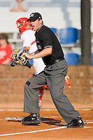 Home plate umpire Luke Engen gets in position to make a call during an Appalachian League game between the Elizabethton Twins and the Johnson City Cardinals at Howard Johnson Field July 3, 2010, in Johnson City, Tennessee.  Photo by Brian Westerholt / Four Seam Images